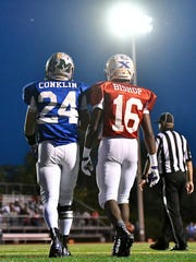 Brandon Conklin of Miami Valley Christian Academy (East/Blue) and Aaron Bishop of Elder (West/Red) exchange some words in the 3rd quarter Thursday, June 8th at Kings High School 2017 SWOFCA East/West All-Star Football Game