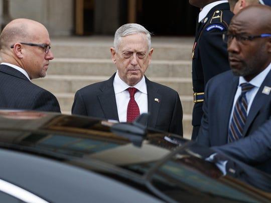 Defense Secretary Jim Mattis prepares to greet Emir of Qatar Sheikh Tamim bin Hamad al-Thani as he arrives during an Honor Cordon at the Pentagon, Monday, April 9, 2018. (AP Photo/Carolyn Kaster)