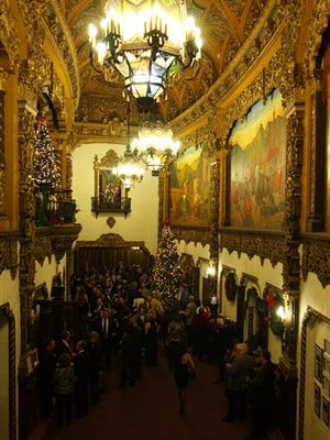 This Dec. 16, 2007 photo shows patrons in the lobby of the St. George Theatre for its 78th anniversary and fourth-annual gala in the Staten Island borough of New York. The St. George Theatre opened in 1929 as a movie-and-vaudeville house that featured live performers like Al Jolson, Kate Smith and Guy Lombardo. Its grand interior is decorated in a Spanish-Italian baroque style with ornate chandeliers, balconies with cast-iron railings, ceilings and walls covered in intricate gold-leaf and plaster designs.