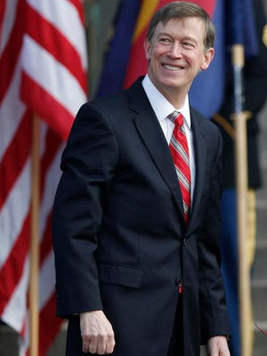FILE - In this Tuesday, Jan. 13, 2015, file photograph, Colorado Gov. John Hickenlooper smiles at spectators after taking the oath of office to begin his second term as the state's top official during inauguration ceremony on the west steps of the Colorado State Capitol in Denver. Hickenlooper, Colorado's term-limited Democratic governor, has just released a personally candid autobiography and is doing the talk show rounds, raising speculation this week that he is positioning himself to join Hillary Clinton's presidential campaign ticket. (AP Photo/David Zalubowski, File)