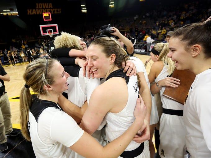 Iowa teammates give senior Chase Coley a group hug