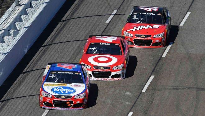 AJ Allmendinger, front, leads Kyle Larson (42), and Kurt Busch (41) during Sunday's race at Martinsville Speedway.