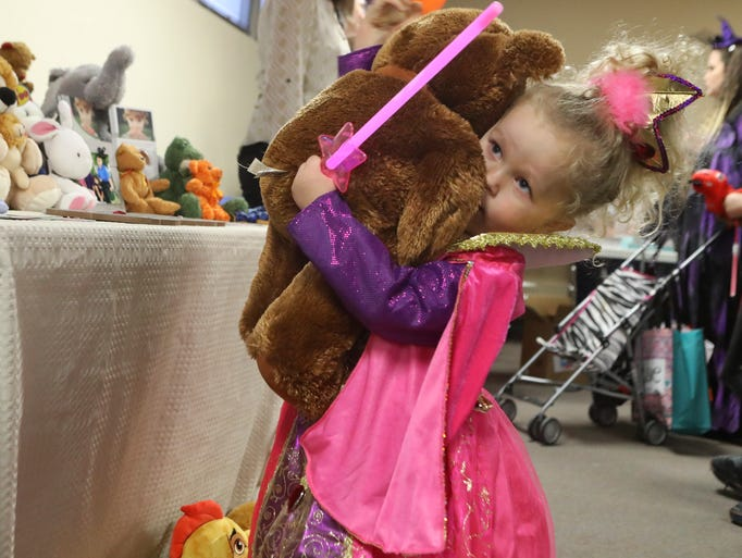 April Nelson, 3, gets a stuffed bear Thursday at the