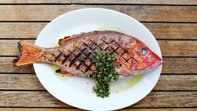 Grilled whole snapper with salsa verde by Chef Gregg McCarthy of The Grand Marlin.