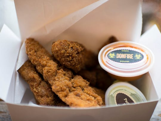 An assortment of boneless tenders and wings from Wishbone