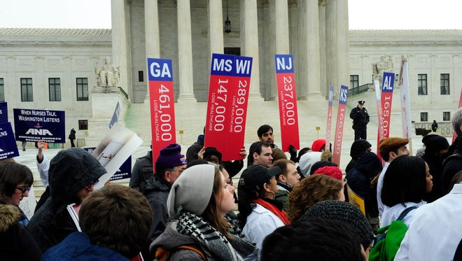 Supporters of the Affordable Care Act rally outside the Supreme Court in Washington where the high court heard a second major challenge to the Affordable Care Act, commonly known as Obamacare.