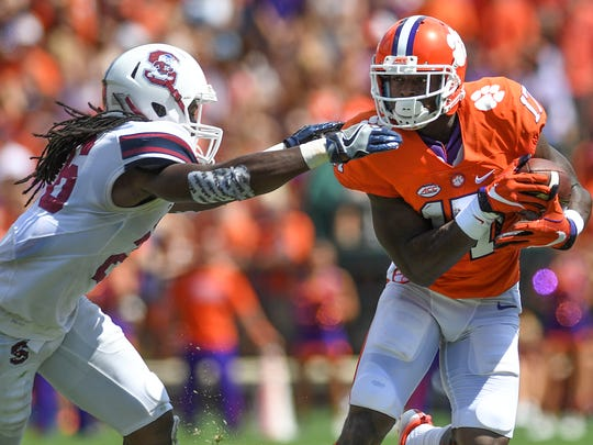 Clemson wide receiver Cornell Powell (17) tries to run past S.C. State defensive back Jason Baxter (26) during the 2nd quarter on Saturday at Clemson's Memorial Stadium.