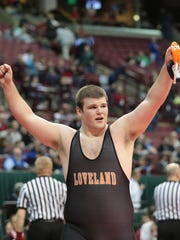 Loveland's Andrew Alten wins the 285 weight class championship at the state championships in Columbus in Julie Renner's first year as AD.  Chris Switzer is Loveland's wrestling coach. Tony Tribble/For The Community Press
