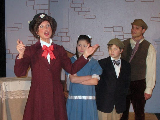 "Mary Poppins (Wendy Colbo) teaches Jane (Libby McDonald) and Michael (Tyson Wolfe) all about ""supercalifragilisticexpialidocious."""