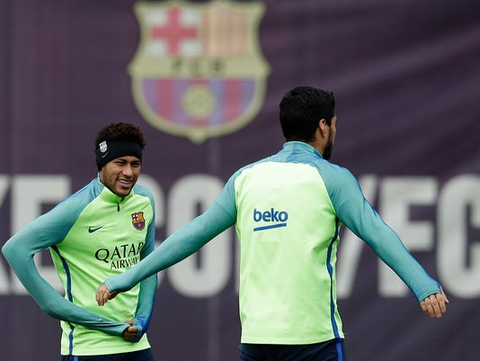 FC Barcelona's Neymar, left, and Luis Suarez attend a training session at the Sports Center FC Barcelona Joan Gamper in Sant Joan Despi, Spain, Saturday, April 1, 2017. Granada will play against FC Barcelona during a Spanish La Liga on Sunday. (AP Photo/Manu Fernandez)