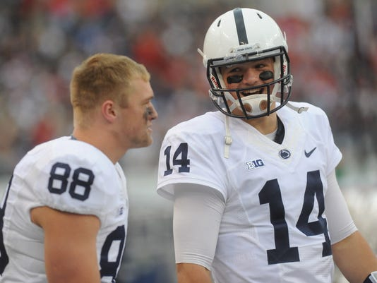 Penn State QB Christian Hackenberg, right, jokes on the sidelines during the Nittany Lions' 31-30 victory over Maryland in Baltimore on Saturday, Oct 24, 2015.