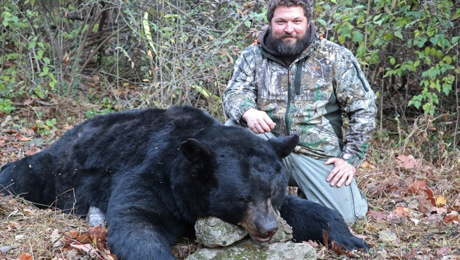 Lebanon resident Grant Ruhl poses with the 662-pound black bear he shot Nov. 21 in Potter County. Ruhl's bear was one of the largest killed during Pennsylvania's 2016 bear hunting season.