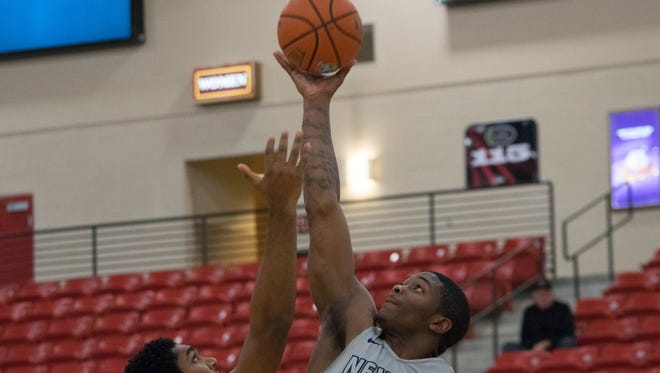 Nevada's Cameron Oliver wins the opening tip against Towson. He tallied 17 points and 13 rebounds in a 81-72 win.