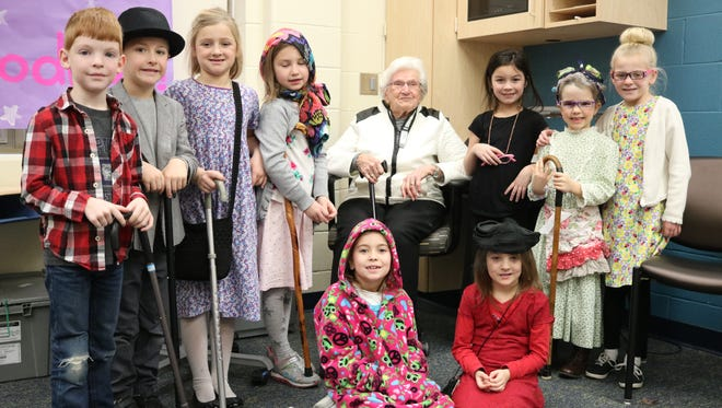 Jean Bodnar, who turned 100 last month, helps Bataan first graders celebrate the 100th day of school.