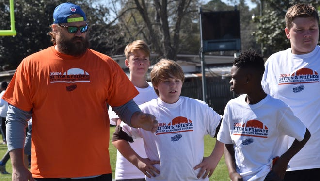 Pensacola resident and Chicago Bears All-Pro offensive lineman Josh Sitton returned to Catholic High to work with area youth at his annual Josh Sitton Pro Camp in March. Sitton will also be participating in the Light Up Learning event, which is his brainchild.