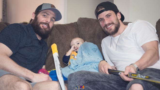 Mike Fisher and Roman Josi visit 2-year-old Trip Phinney at his home in Murfreesboro. Photo provided by Paperdolls Photography.