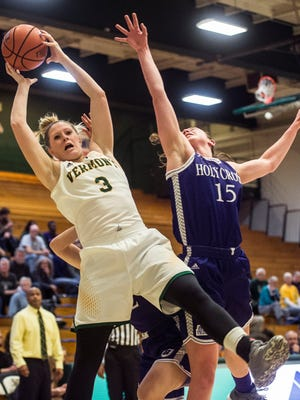 UVM #3 Sydney Smith snags the rebound from Holy Cross #15 Madelyn Ganser during the University of Vermont women's basketball 63-52 win at Patrick Gymnasium Wednesday night, Nov. 30, 2016.