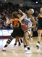 Mississippi State's Victoria Vivians (35) is fouled by Oklahoma State's Jaden Hobbs (23). Mississippi State played Oklahoma State in the second round of the NCAA Women's basketball tournament at Humphrey Coliseum on Monday, March 19, 2018.