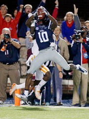 Mississippi wide receiver Vince Sanders (10) leaps into the end zone with a 39-yard touchdown reception against Tennessee in the first half .