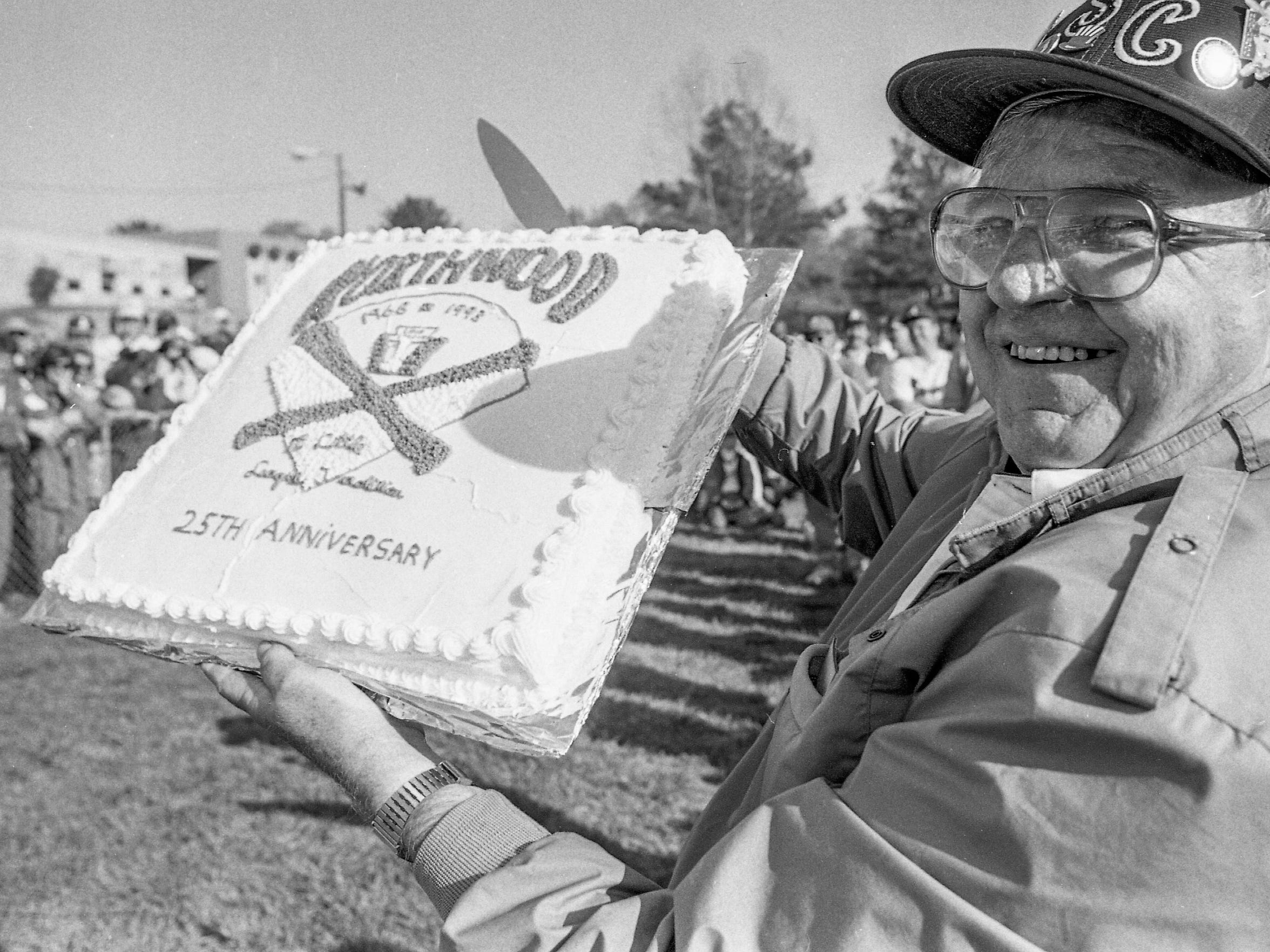 Northwood Little League founder Bob Tillison displays a cake presented during the 1993 opening day ceremonies.