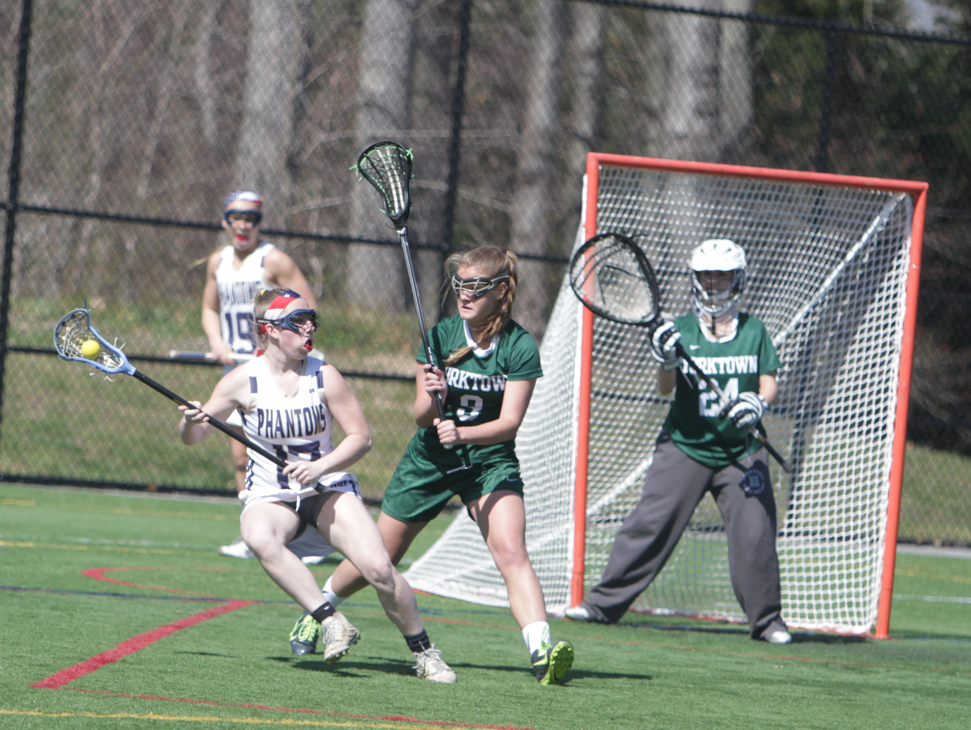 Bayport-Blue Point's Kelsi Lonigro (17) is defended by Yorktown's Mary Kate Murphy during a girls lacrosse game between Yorktown and Bayport-Blue Point in the Gains for Brains Lax Showcase at Cold Spring Harbor High School on Saturday, April 16th, 2016. Bayport-Blue Point won 16-8.