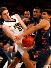 Iowa Hawkeyes forward Nicholas Baer (51) and Illinois