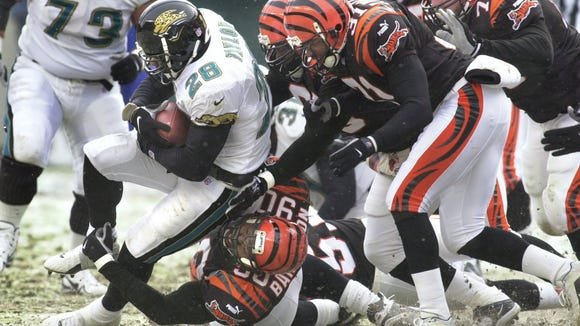 Cincinnati Bengal players converge upon the Jacksonville Jaguars' Fred Taylor during the second quarter Sunday December 17, 2000 at Paul Brown Stadium. Making the tackle is Michael Bankston. Cincinnati Enquirer photo by Gary Landers