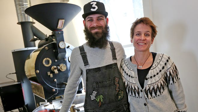 Alec Tod, left, and Diane McAndrews stand by their roaster at Indie Coffee Roasters in Carmel, Wednesday, March 7, 2018. Jenny Tod andKevin McAndrews (both not pictured) also own the coffee business.
