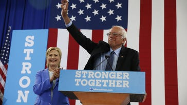 Sen. Bernie Sanders, right, formally endorses Hillary Clinton, left, for the Democratic presidential nomination July 12 in Portsmouth, N.H. Some State Democrats believe Sanders would be a better candidate than Clinton, but state delegates hope supporters of both will unite.