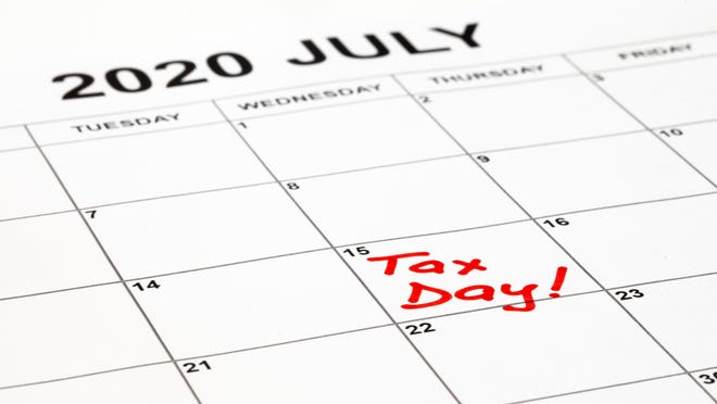 Taxes due date is set for 15th July 2020 due to coronavirus outbreak. Calendar page with Tax Day written in red, remainder to pay taxes. Filling and payment was extended by the government.