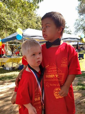 Lincoln County residents Gabriel Nanz and Preston Miller participated in the  Down Syndrome Foundation of Southeastern New Mexico's annual Buddy Walk in Roswell Oct. 15.