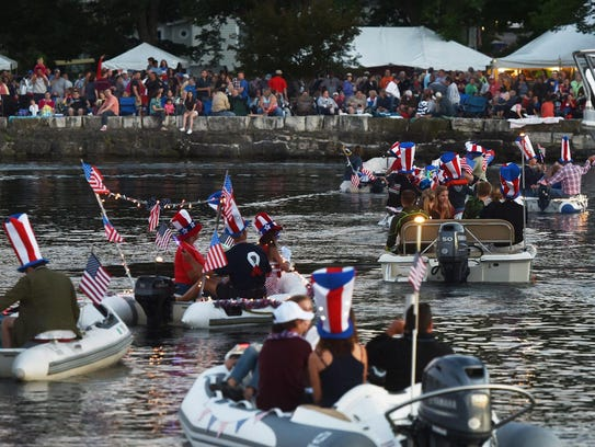 Patriotically decorated vessels head onto the water