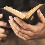 Who decides which Bible interpretation to teach?