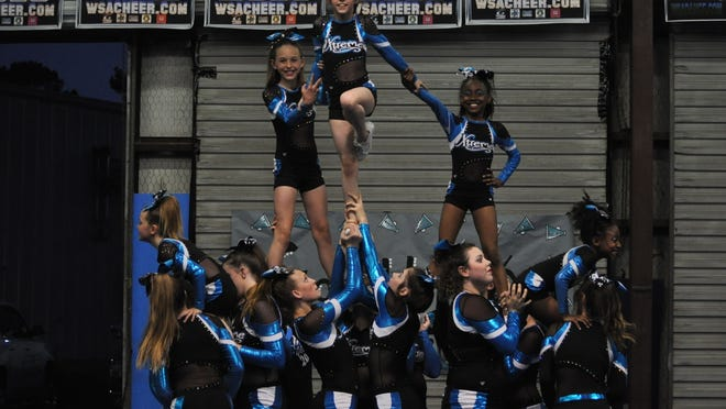 The cheer squad from Xtreme Athletics in Pineville practices one last time before they head to finals in Pensacola, Florida on Saturday. The team has worked since July on the two minute and 30 second routine they will perform at the competition.