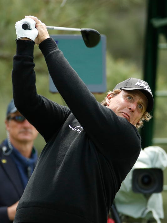 Phil Mickelson hits a drive on the 18th hole during the fourth round at the Masters golf tournament Sunday, April 8, 2018, in Augusta, Ga. (AP Photo/Charlie Riedel)
