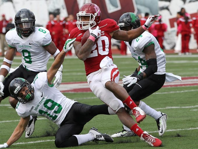 Oct 4, 2014; Bloomington, IN, USA;  Indiana Hoosiers running back D'Angelo Roberts (20) runs the ball during the fourth quarter against the North Texas Mean Green at Memorial Stadium. Indiana defeated North Texas 49-24. Mandatory Credit: Pat Lovell-USA TODAY Sports