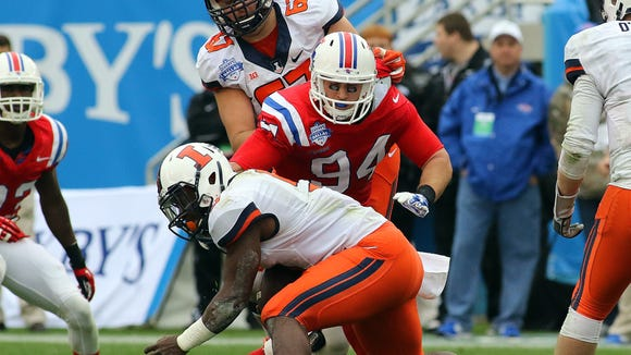 Houston Bates (94) helped Louisiana Tech beat Illinois