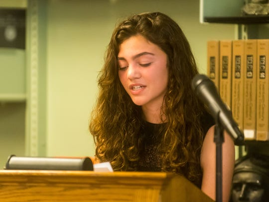 Vineland History Club member Marissa Marchese delivers a biography on Wall of Warriors honoree Richard Flaim during the Sixth Annual Vineland High School Staff Recognition Ceremony at Vineland High School on Wednesday, May 31.