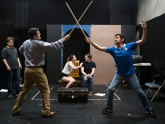 Frank Rosamond, left, rehearses a sword fighting scene
