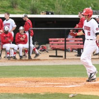 Austin Peay infielder Logan Gray (15) rips a single against Southeast Missouri in 2014
