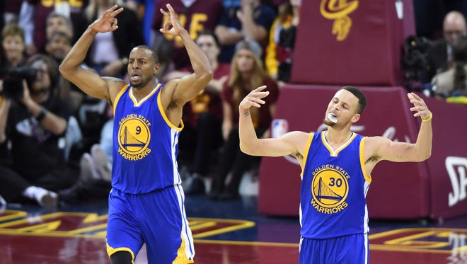 Golden State Warriors guard Stephen Curry (30) and forward Andre Iguodala (9) celebrate their Game 4 win vs. the Cleveland Cavaliers in the NBA Finals.