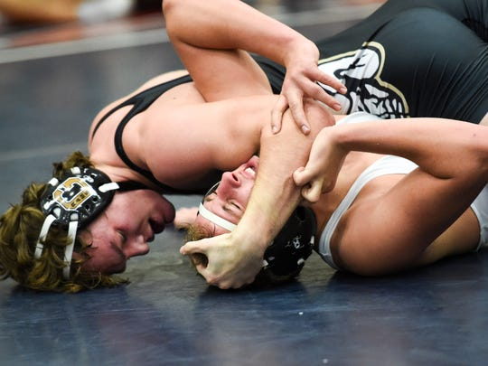 Glenwood's Anthony Sherry works to control Dowling's Greg Hagan in a 182lb match on Saturday, Jan. 21, 2017, during the Ed Winger Classic wrestling tournament at Urbandale High School.