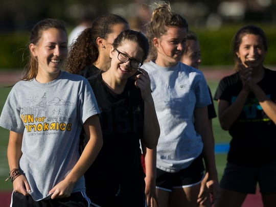 Members of the First Baptist Academy girls soccer team share a laugh while they participate in practice Monday, Jan. 9, 2016 in Naples. The girls' varsity team has never recorded a winning season until last year, when they won ten games. This season, however, the Lions are 15-2 going into district playoffs.