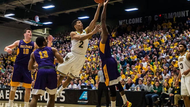 UVM's Trae-Bell Haynes drives the hoop through Albany's defense during the America East Championship at Patrick Gym last year.