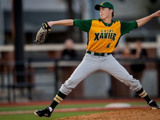 St. Xavier's Andrew Littlefield pitches in relief during