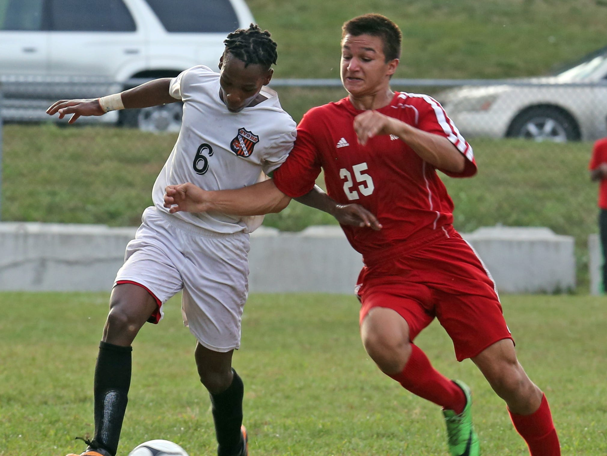 Spring Valley's (6) and North Rockland's (25) battle Dimitri Pray for control of the ball during boys soccer game at Spring Valley High School on Sept. 20, 2016.