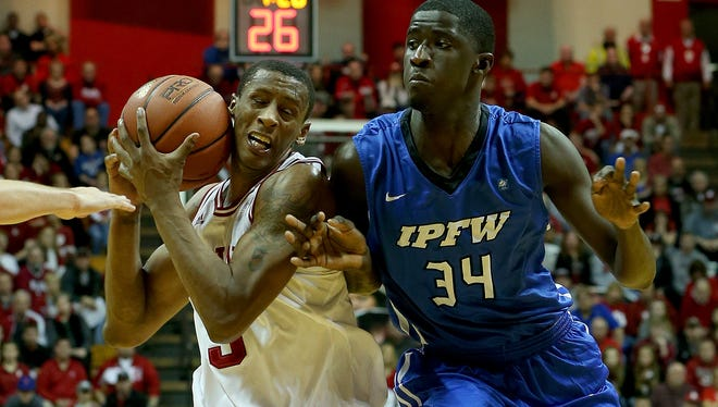 Indiana Hoosiers forward Troy Williams (5) is fouled by IPFW Mastodons forward Racine Talla (34) on his way to the hoop at Assembly Hall on Dec. 9, 2015.
