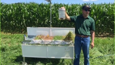 The U.S. Department of Agriculture, Natural Resources Conservation Service's (NRCS) Regional Soil Health Specialist, Justin Morris demonstrates the NRCS Rainfall Simulator.