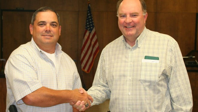 Baylor County Judge Rusty Stafford, right, congratulates new Baylor County Sheriff Jason Zeissel Tuesday after Zeissel was sworn into the new post. Zeissel has about 15 years of law enforcement experience including three years as a deputy sheriff in Knox County and 12 years as a Texas Department of Public Safety trooper based out of Seymour.