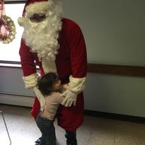 Breakfast with Santa spreads cheer to local foster children, families